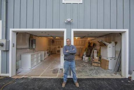 Peter Glass, owner of Meadowbrook Builders, at a construction site for a garage in Briarcliff Manor, N.Y.